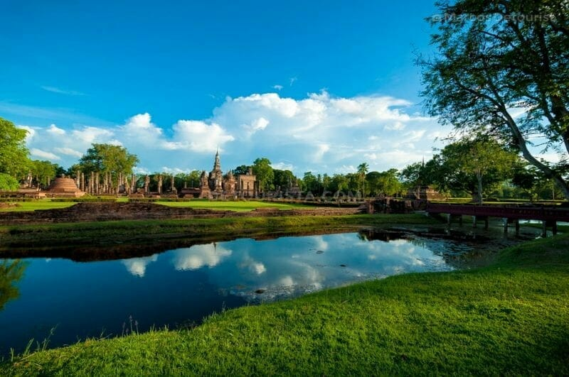 Moat and temple ruins in Sukhothai Historical Park