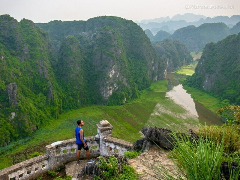 Overlooking the massive limestone mountains and winding river at Tam Coc, in Ninh Binh, Vietnam, on September 2015
