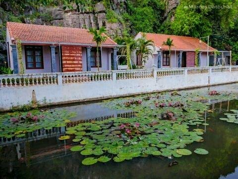 Tonkin village-inspired cottages with blooming lilies at Mua Caves Eco Lodge, in Ninh Binh, Vietnam, on September 2015