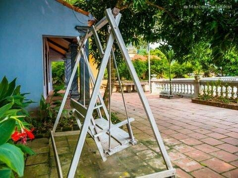 Cute wooden swing betside my cottage at Mua Caves Eco Lodge, in Ninh Binh, Vietnam, on September 2015