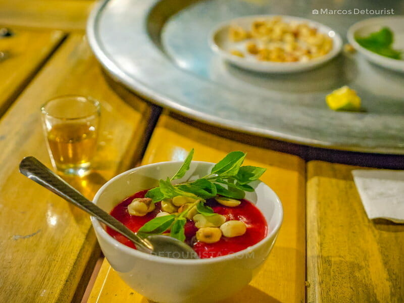 Goat blood soup in vibrant sanguine-red served at the restaurant, in Mua Caves Eco Lodge, Ninh Binh, Vietnam, on September 2015