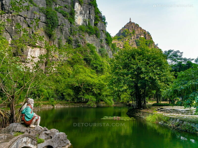 Scenic view of the Mua Mountains from a tranquil pond at the eco lodge, in Ninh Binh, Vietnam, on September 2015