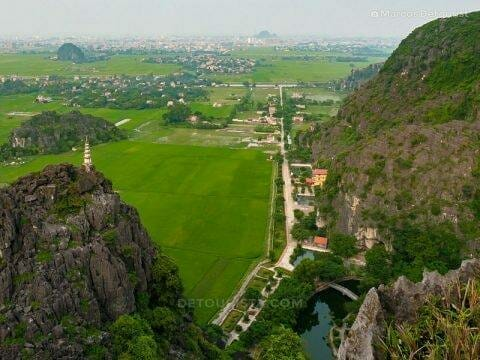 View of Mua Caves Eco Lodge (bottom right) and Ninh Binh city center (back) on my way to the top of the viewpoint, in Vietnam, on September 2015