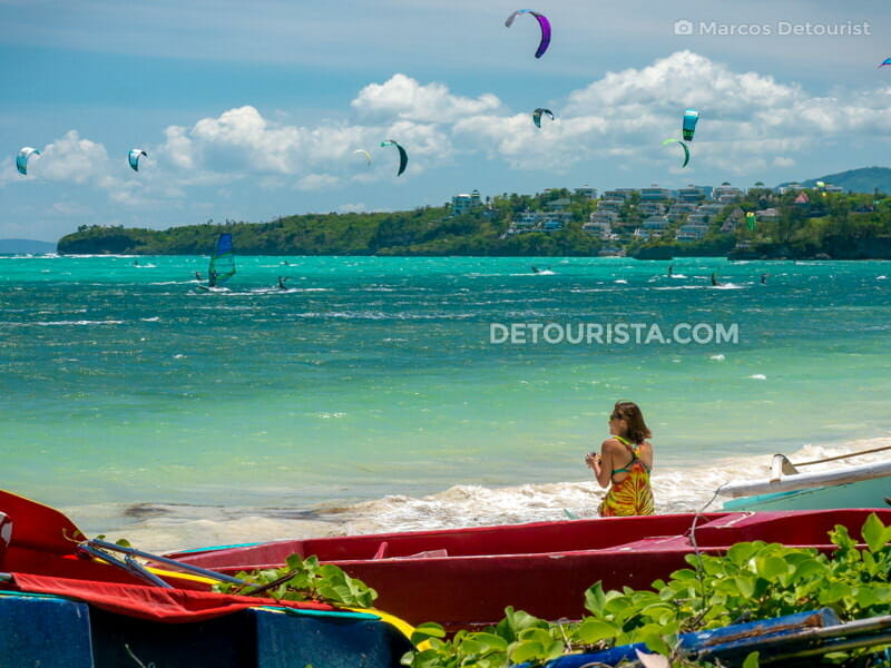 Girl watching windsurfers at Bulabog Beach, in Boracay Island, Malay, Aklan, Philippines
