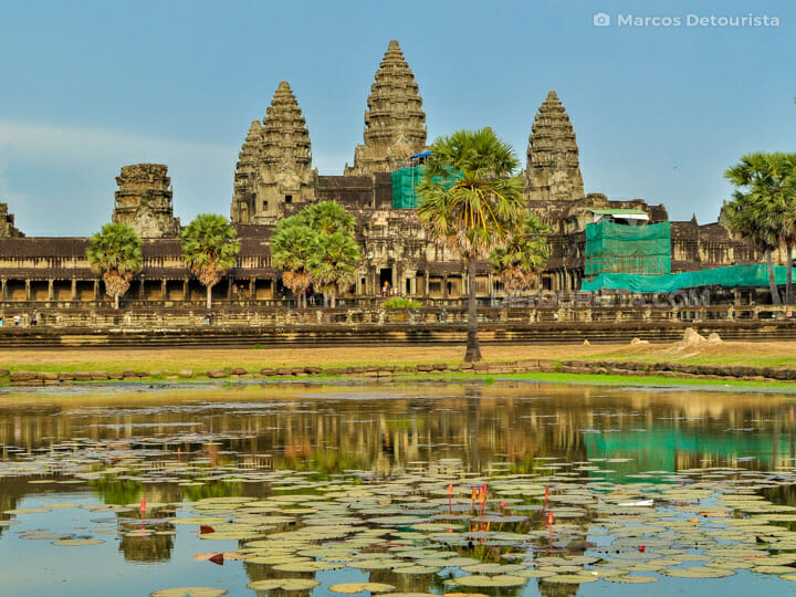 View of Angkor Wat (temple) from the lotus-filled reflecting pond, in Siem Reap, Cambodia