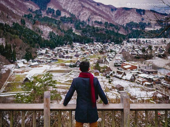 Marcos with Shirakawa-go village view from Shiroyama viewpoint, Japan