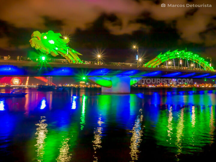 Dragon Bridge brightly lit up along the Han River, at night, in Da Nang, Vietnam