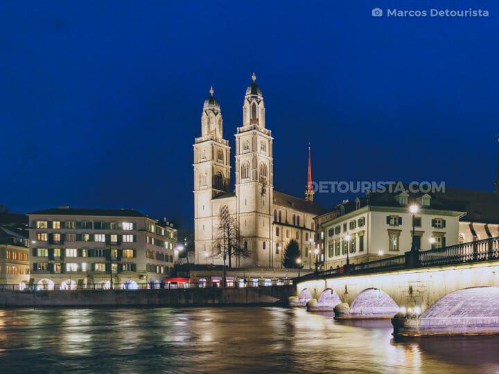 Zurich, Switzerland at night - Grossmünster Church and Muenster Bridge