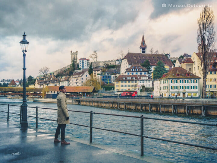 Marcos at Lucerne Old Town facing Speuerbrucke (bridge) and Muse