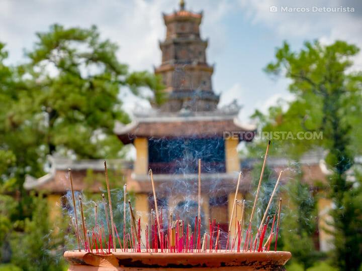 Burning incense at Thien Mu Pagoda, along the Perfume River, in Hue, Vietnam