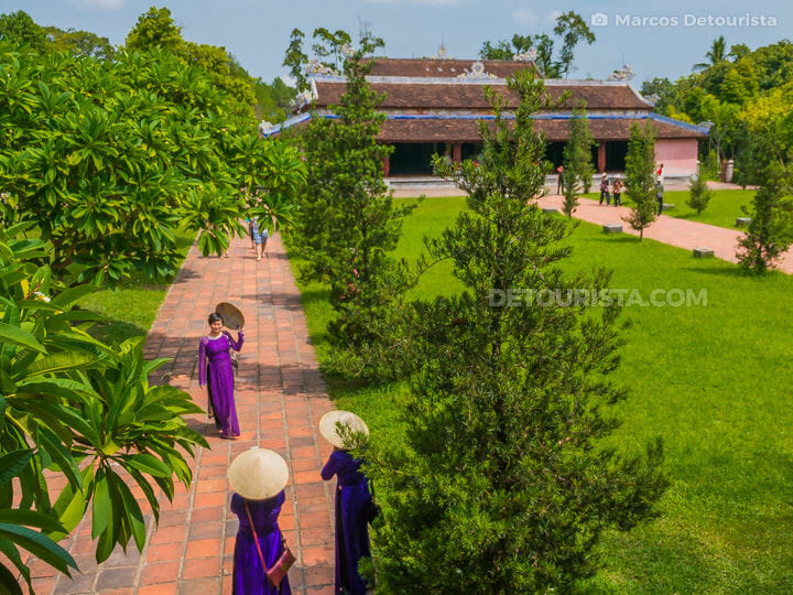 Vietnamese tourists in traditional outfit at Thien Mu Pagoda in Hue, Vietnam