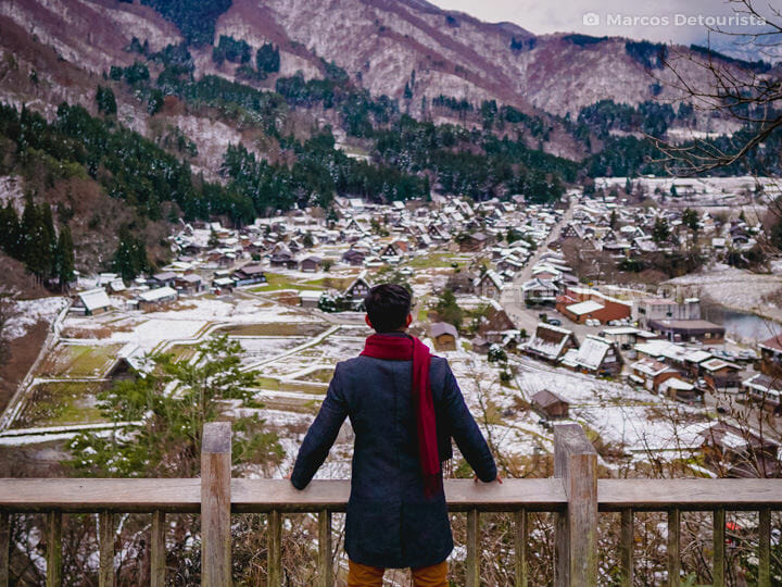 Marcos with Shirakawa-go village view from Shiroyama viewpoint,