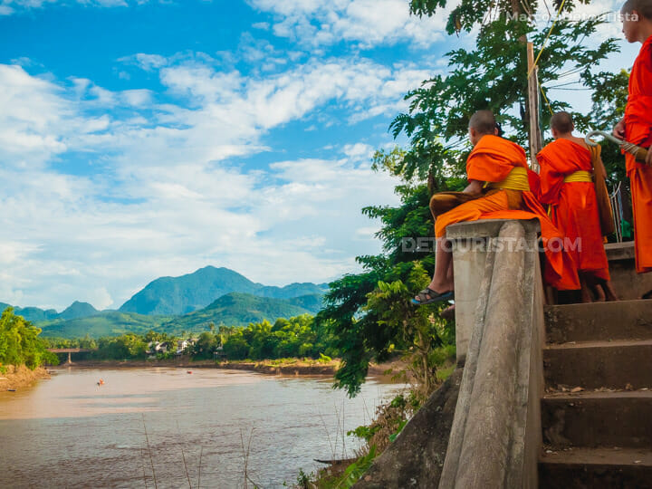 Monks at the riverside in Luang Prabang, Laos