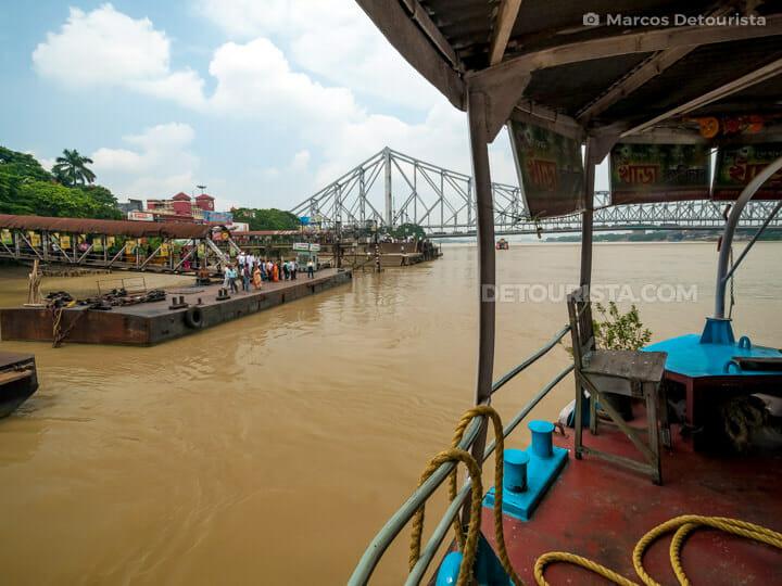 Hooghly River ferry landing & Howrah Bridge, in Kolkata, India