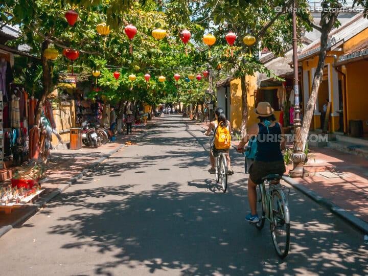 Tourists on Bicycles Exploring Hoi An