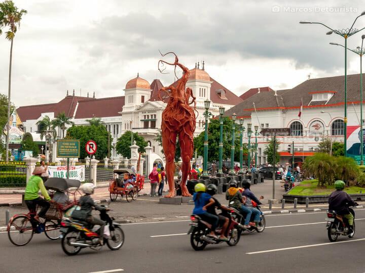 Dutch-colonial buildings & public art along Malioboro Street, in