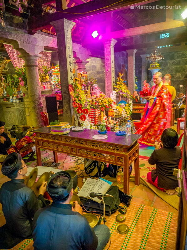 Traditional costumes, music, and chanting, at Thai Vi Temple nea