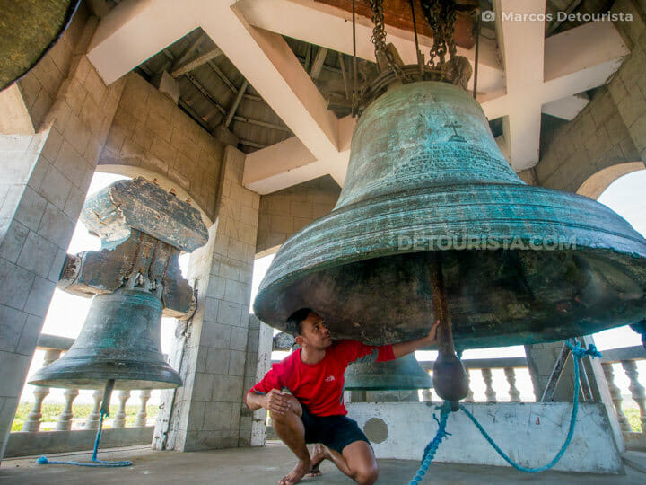 Under the largest bell at Panay Church. in Panay, Capiz, Philippines